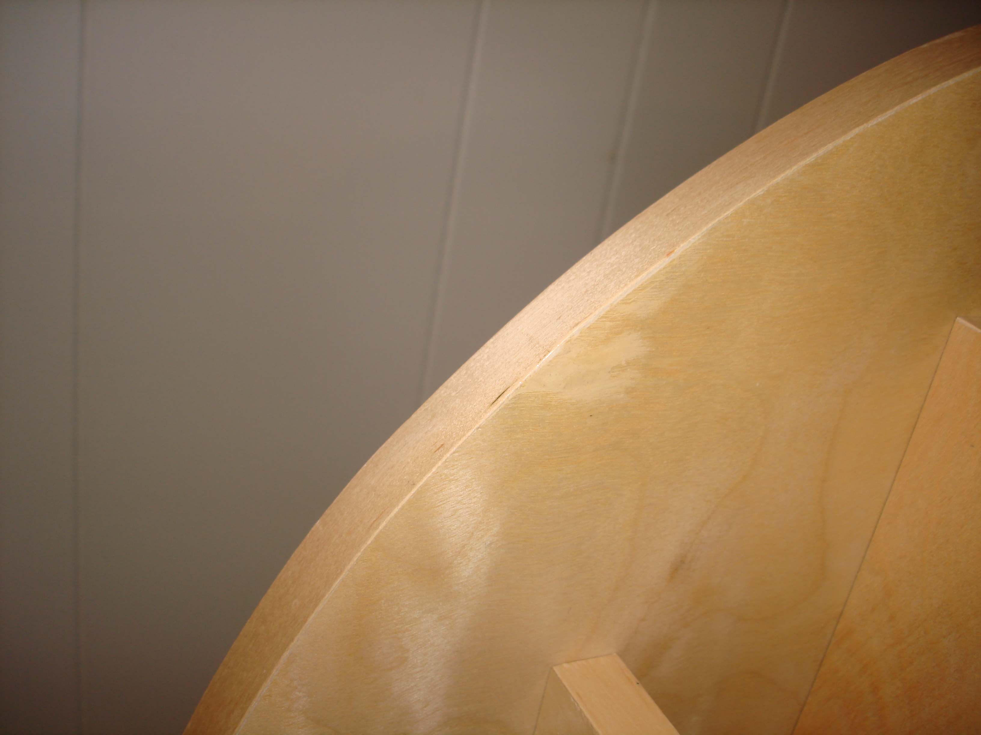 View of the plywood defect after wood filler and banding applied