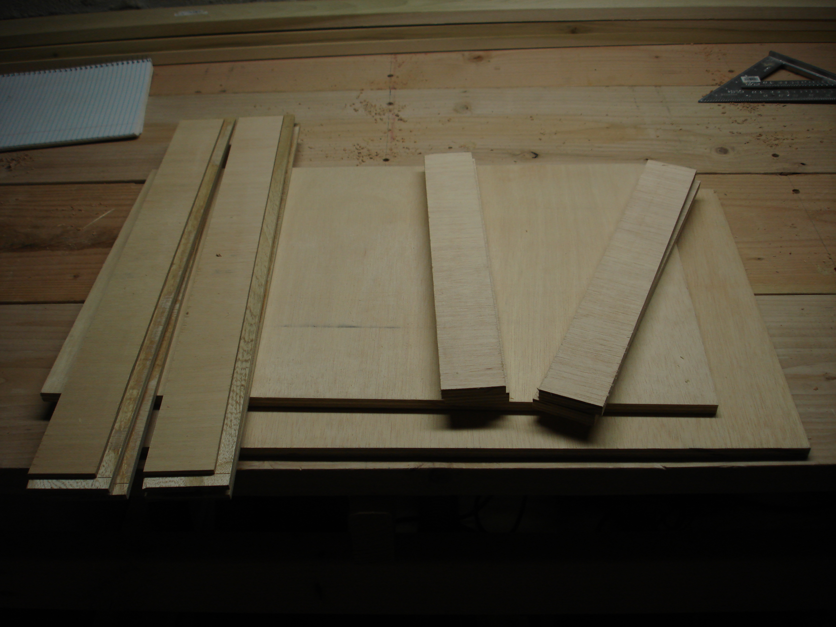 I needed to wait for a flat-bottom router bit to arrive, so I made drawers in the mean time.  These are the cut components for the three drawers