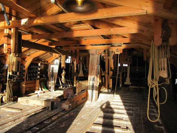 A look inside the mill. A log is waiting to be sawn into boards on the sled next to the support beam.