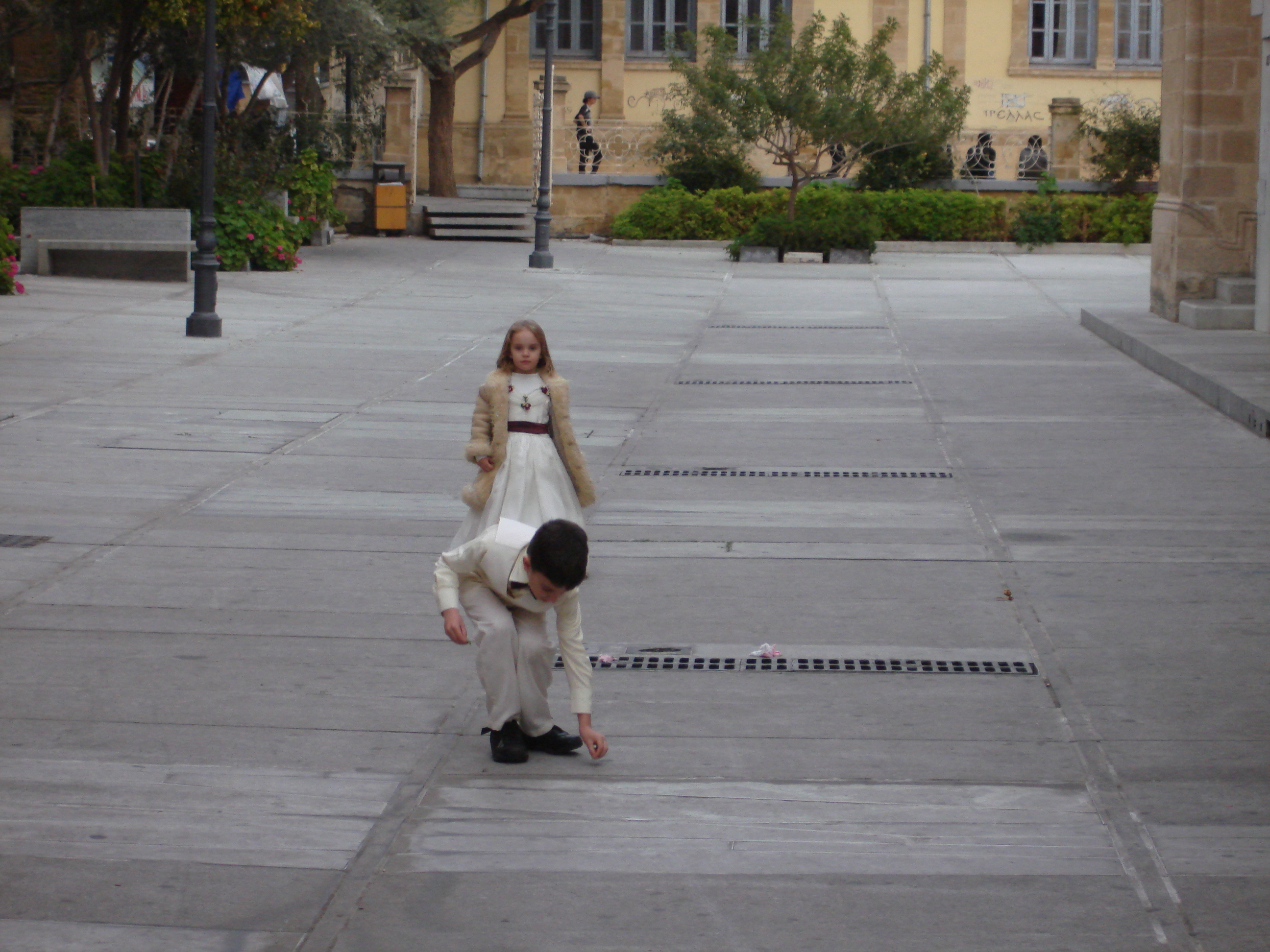 Two children attending a nearby wedding
